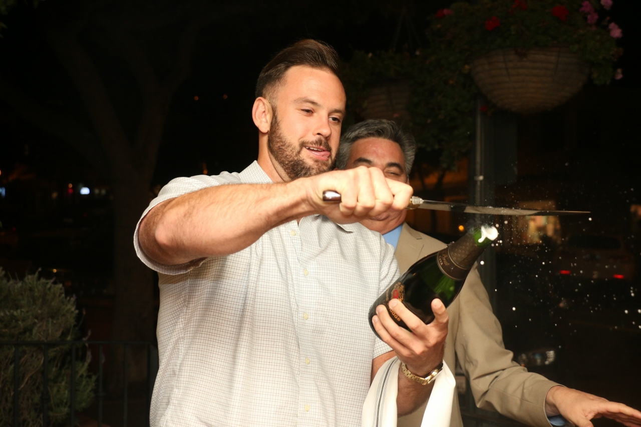 Participants learned how to perform the art sabrage, a style of opening Champagne bottles by taking the top of a bottle off with the blunt end of a knife or sword.