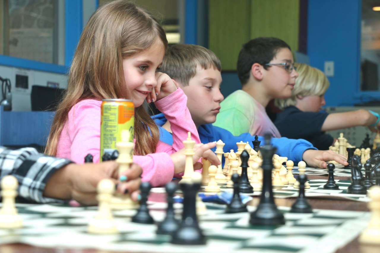 Mya Host participates in the small chess tournament Tuesday, March 14, hosted at the Boys & Girls Club of the South Coast Area.
