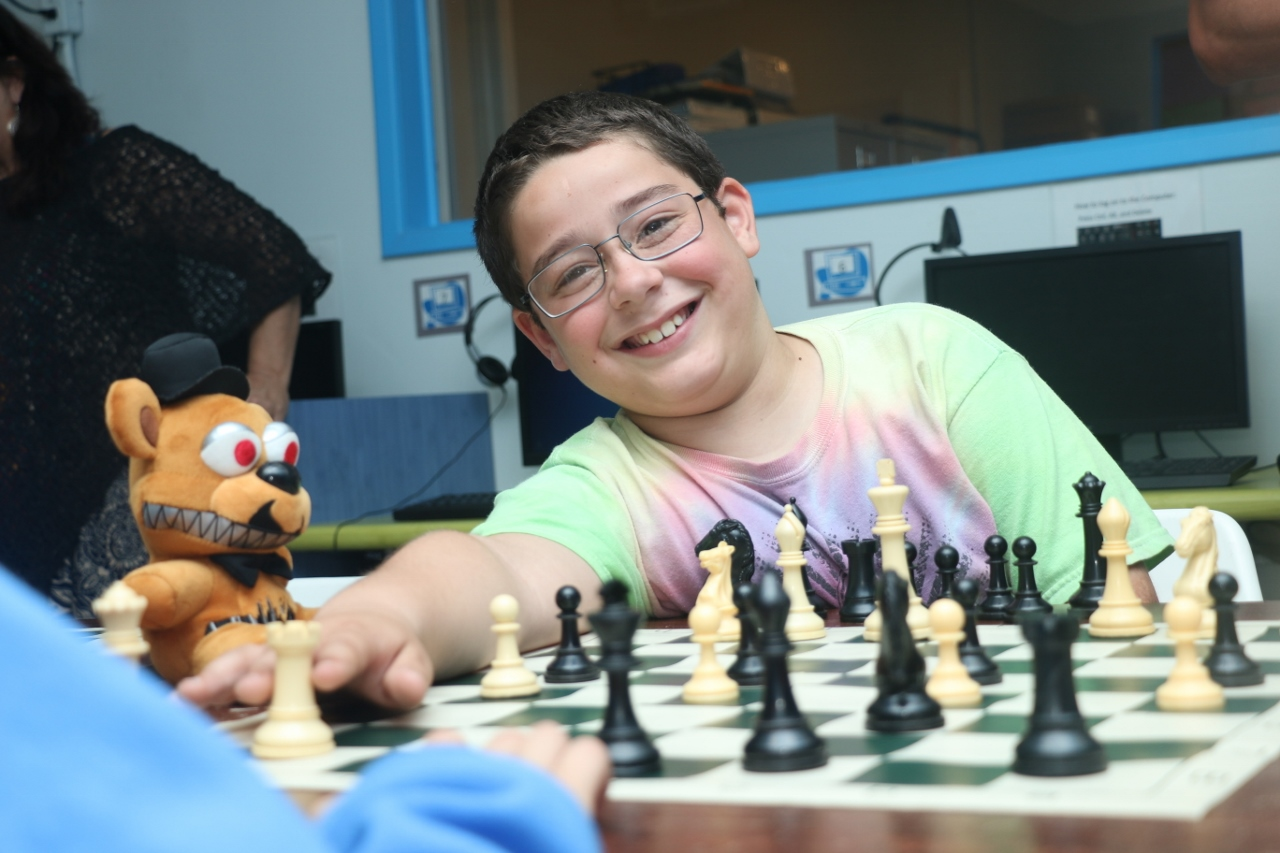 Ariel Acuna played a game of chess in the small tournament on Tuesday, March 14, at the Boys & Girls Club of the South Coast Area.
