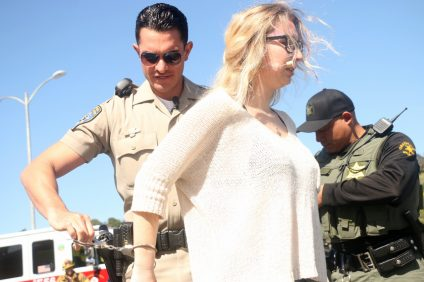 A high school student portraying a drunk driver is arrested during the 'Every 15 Minutes' mock DUI incident on Tuesday, March 28, at San Clemente High School.