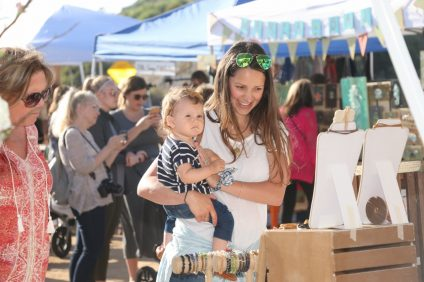 Kiersten Crivello and her daughter, Annabella, 1, view various merchant booths at the first North Beach farmers' market on Wednesday, April 12. The Market at North Beach takes place 3-7 p.m. on Wednesdays. Photo: Eric Heinz