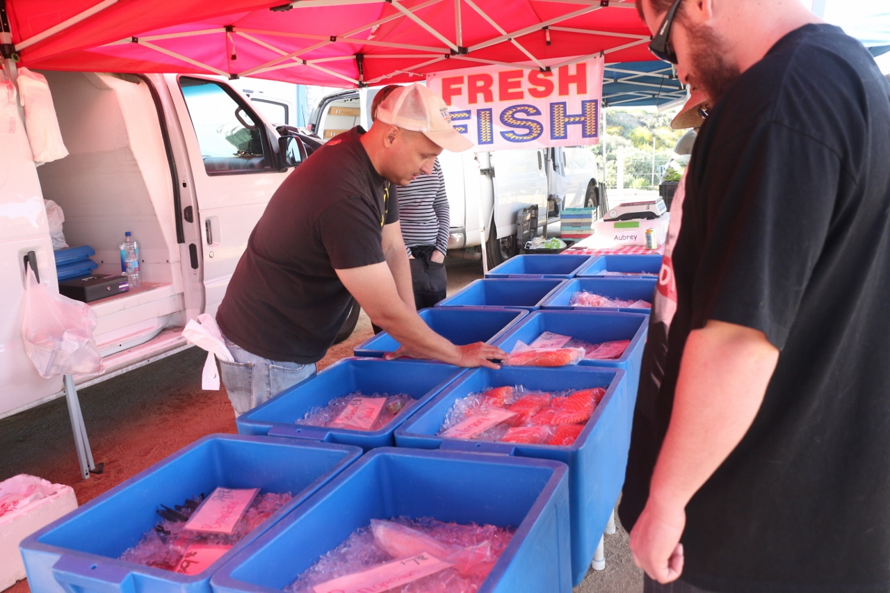 Seafood from Dry Dock Fish Co. in Irvine was brought in by representatives at the first North Beach farmers market on April 12.