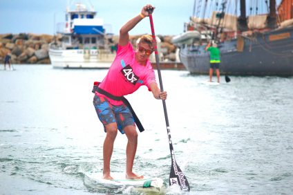 A participant competes at last year's Mongoose Cup, a stand-up paddleboard race, music show, community gathering and more. Photo: Steve Breazeale