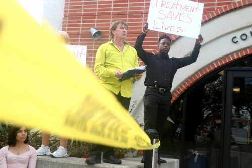 Robert Noble, center, leads a protest against the city's zoning ordinance regarding sober living homes. be Photo: Eric Heinz