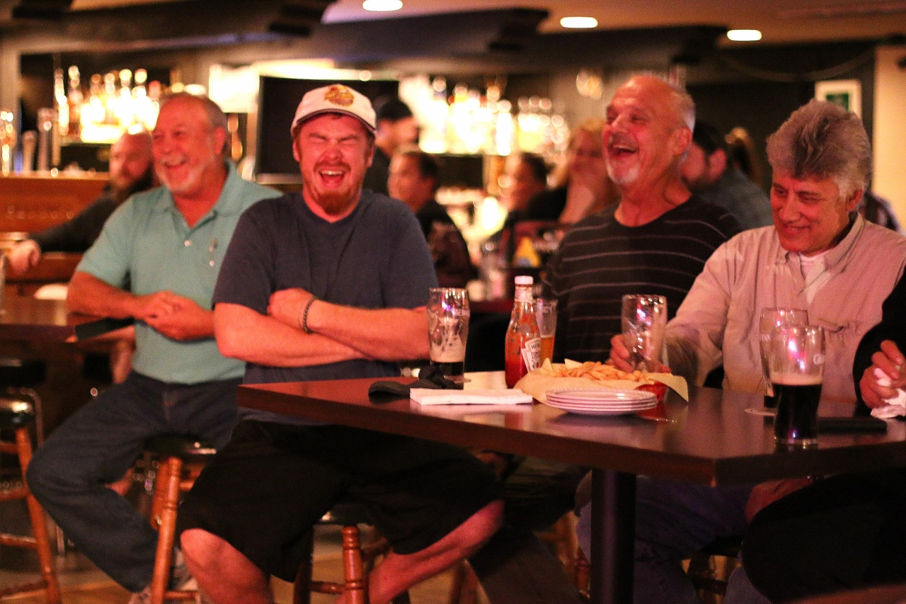 Crowd members laugh at a joke told by Dave Nystrom on May 17 at Molly Bloom's Irish Bar & Restaurant. Photo: Eric Heinz
