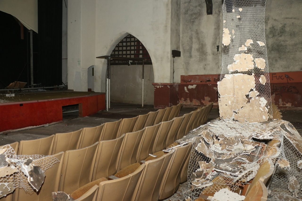 Seats inside the Miramar Theater along with plaster and other materials have deteriorated since the closing of the facility. Photo: Eric Heinz