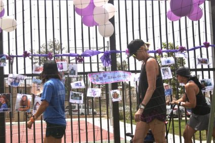 "People walked by the ""wall of love"" with photos of people who died after battling cancer during the San Clemente Relay for Life on Saturday, Aug. 26, at Jim Johnson Memorial Sports Park. Photo: Eric Heinz"