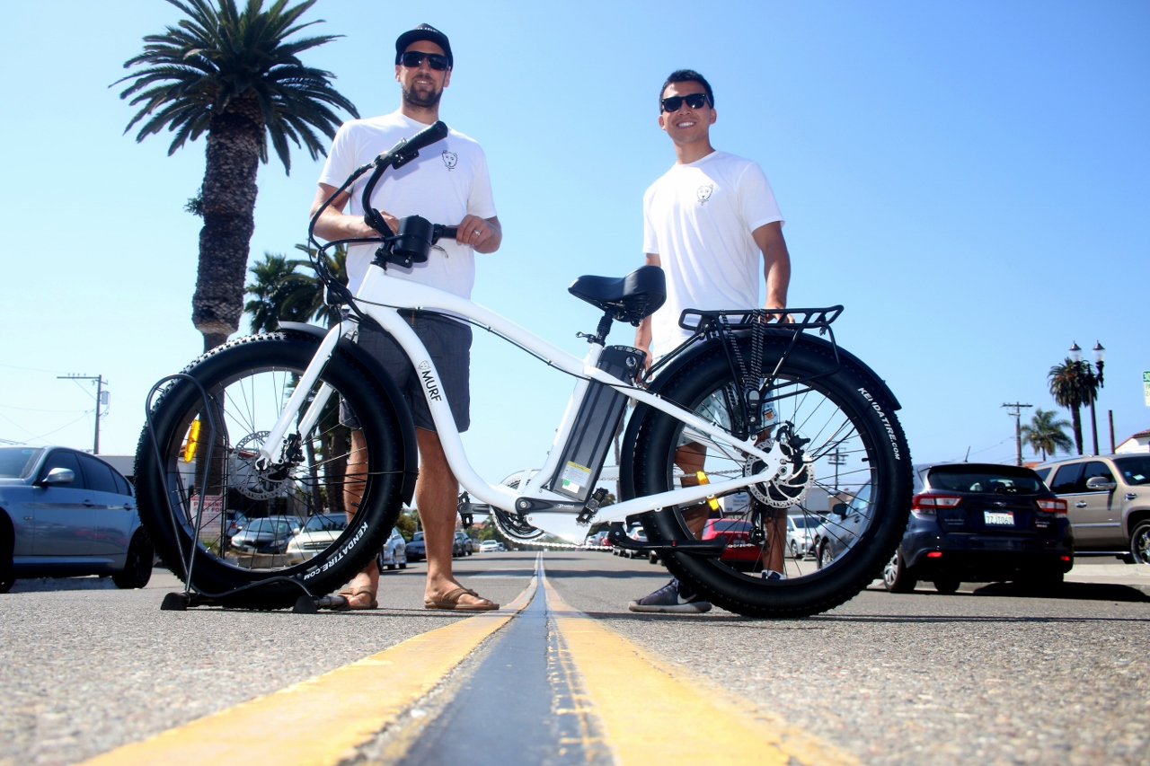 Josh Jones, left, the owner of Murf Electric Bikes, stands with his business partner, Alan Kang. The business opened a storefront in March. Photo: Eric Heinz