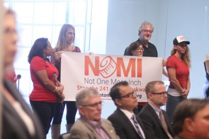 "Protestors of the proposed toll roads through San Clemente and south Orange County hold a sigh with the slogan ""Not One More Inch"" on Thursday, Oct. 12, at the Transportation Corridor Agencies meeting in Irvine. Photo: Eric Heinz"