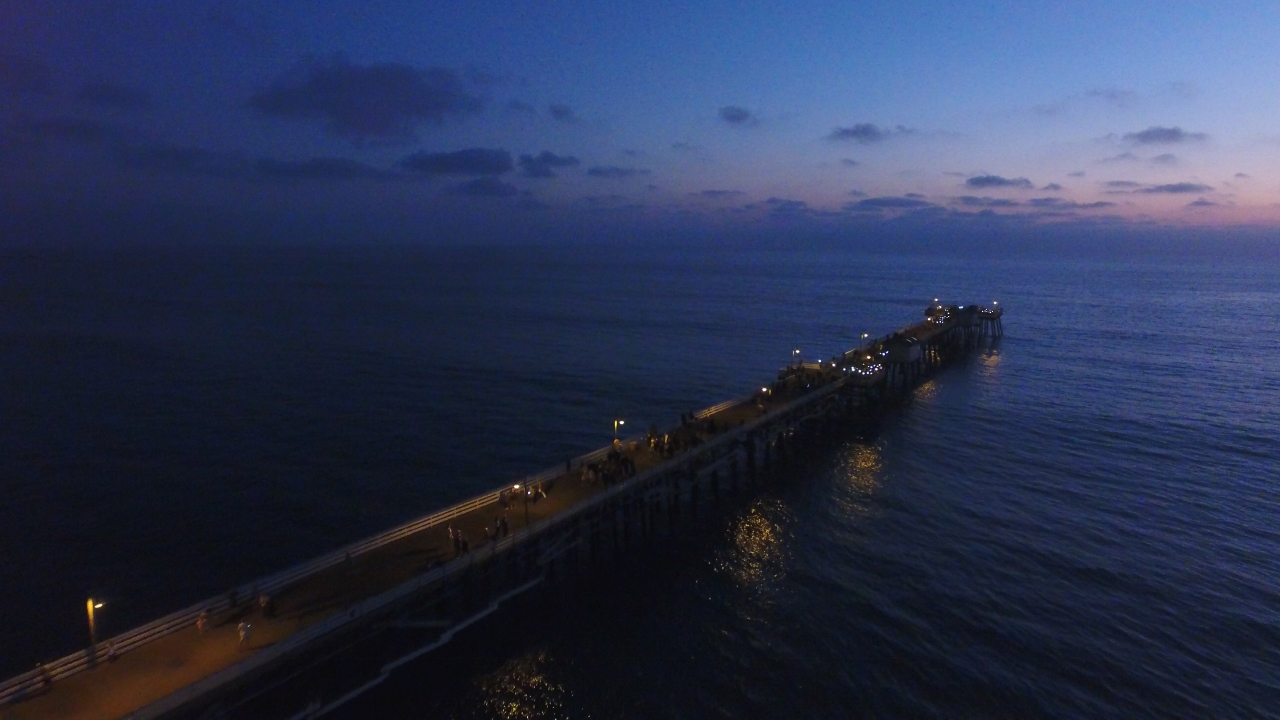 People used flashlights and cell phone light to create a twinkling constellation around the edge of the San Clemente Pier on Oct. 13 during Pier Pride's fundraising event. Photo: Courtesy of Jim Habig