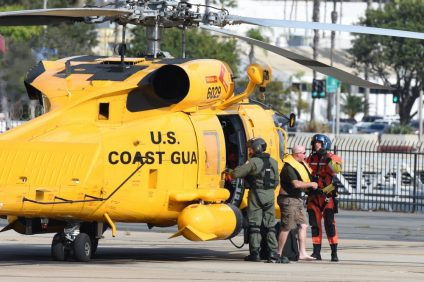 A boater is helped off of a Coast Guard Sector San Diego MH-60T Jayhawk helicopter by the crew at Coast Guard Sector San Diego November 6, 2017. The man was rescued after his 18-foot cuddy cabin boat began taking on water 12 miles west of San Onofre State Beach, San Clemente, California. (U.S. Coast Guard photo by Petty Officer 2nd Class Joel Guzman/released)