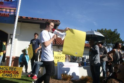 Jackson Hinkle, the president of the San Clemente High School club Team Zissou, leads a protest march on Dec. 30 on Avenida Del Mar. Photo: Eric Heinz
