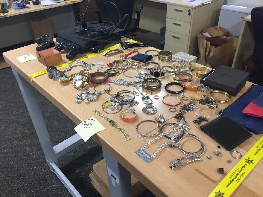 Various items were recovered by Orange County Sheriff's Department after three people were arrested for targeting open houses and stealing from the homes. Photo: OCSD