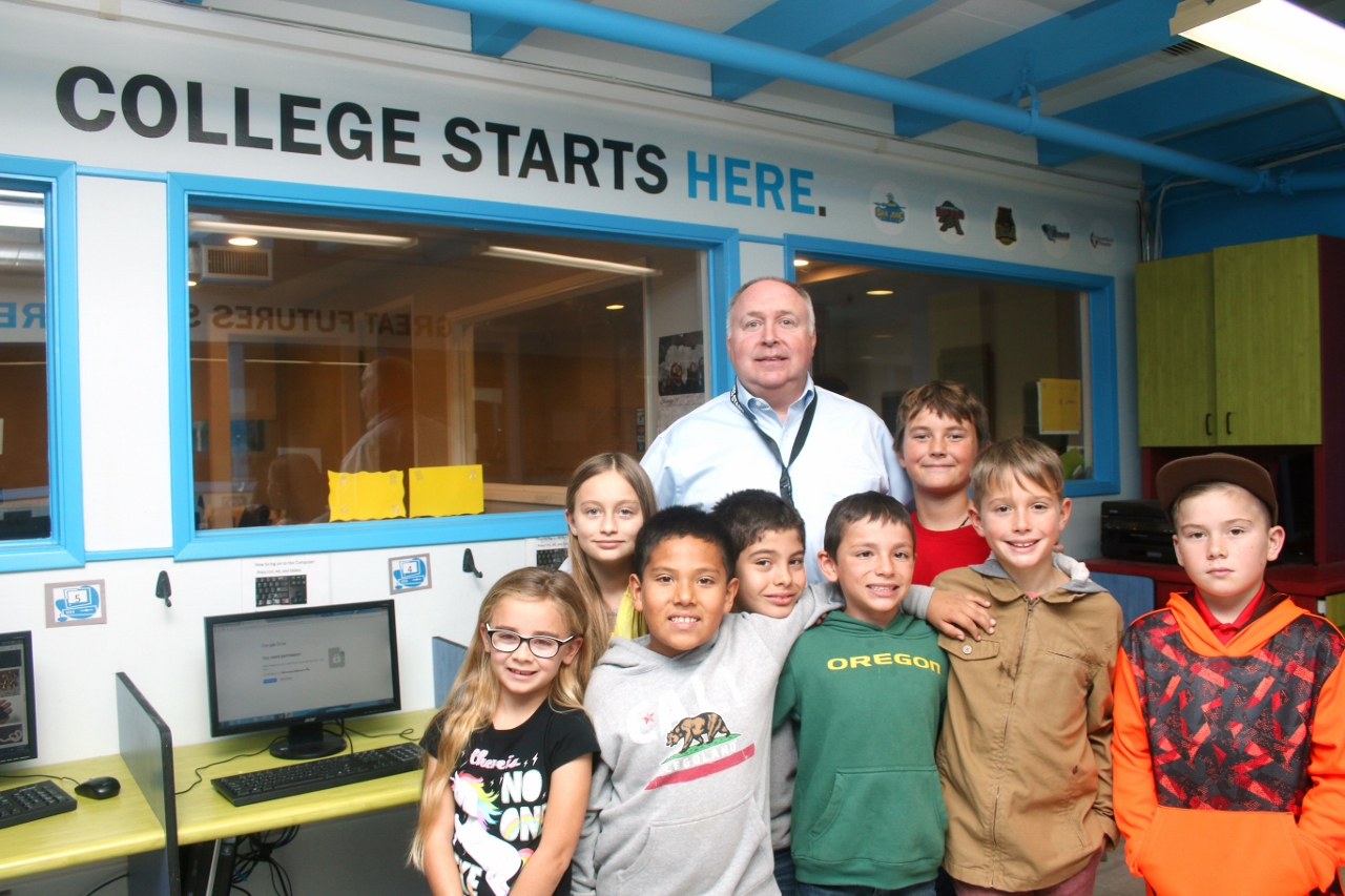 Terence Hughes, back row, the new chief executive officer of the Boys & Girls Club of the South Coast Area, has worked at various clubs prior to joining San Clemente's branch. Photo: Eric Heinz