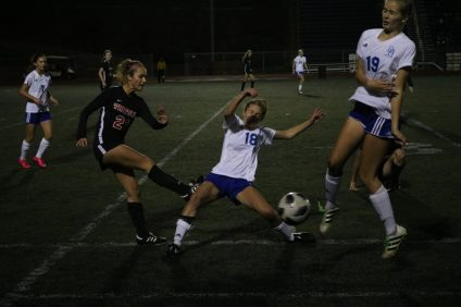 Two Dana Hills players block a kick from San Clemente's London Irwin (left). San Clemente and Dana Hills played to a 1-1 draw on Tuesday, Jan. 9 at Dana Hills High. Photo: Zach Cavanagh