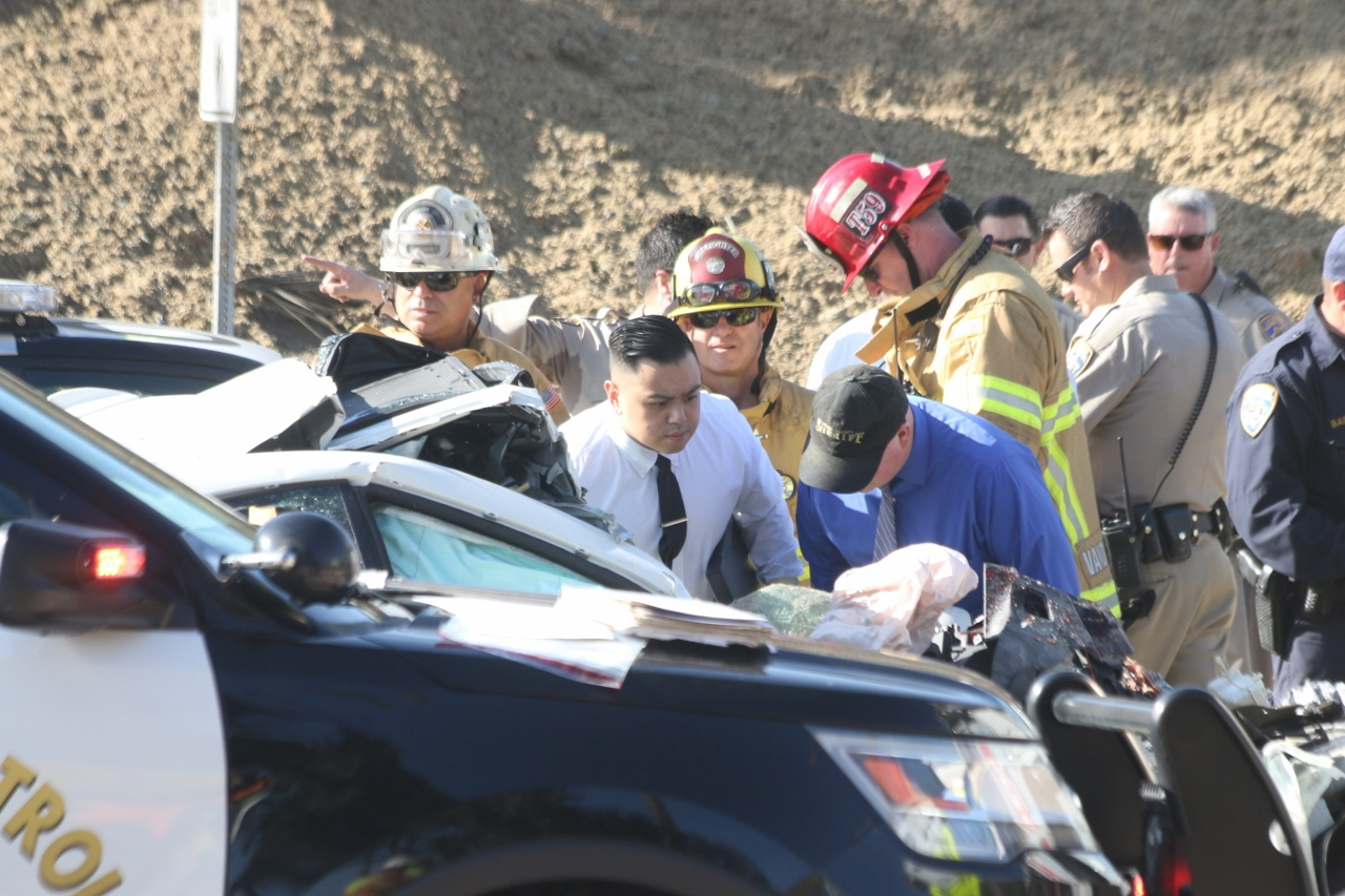 Traffic investigators and firefighters responded to a fatal car collision on Wednesday morning, Jan. 17. One man in his mid-60s died at the scene, CHP officials said. The body of the man had already been removed from the car when this photo was taken. Photo: Eric Heinz