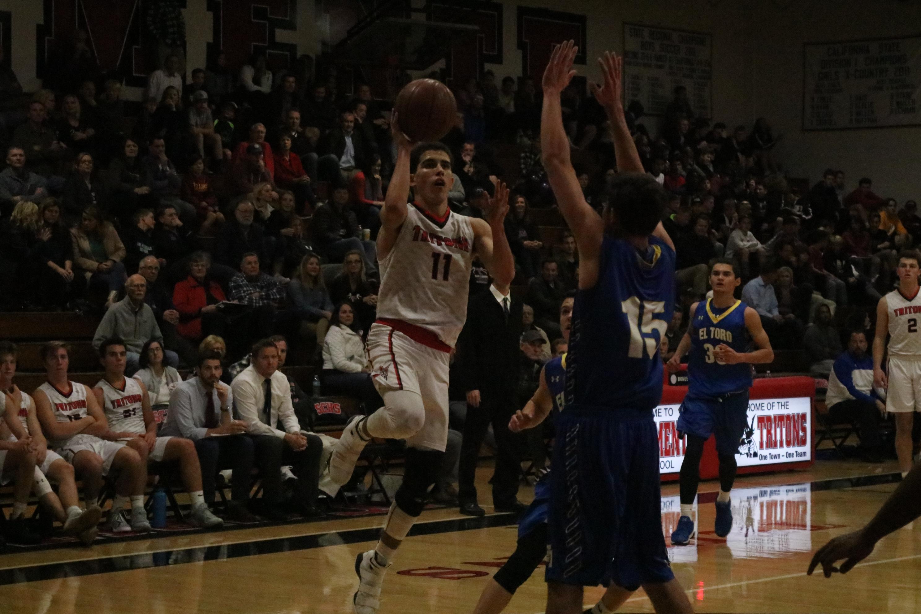 Jacob Nemeth rises up for a lay-up. Photo: Zach Cavanagh