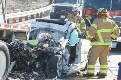 Traffic investigators and firefighters responded to a fatal car collision on Wednesday morning, Jan. 17. One man in his mid-60s died at the scene, CHP officials said. Photo: Eric Heinz