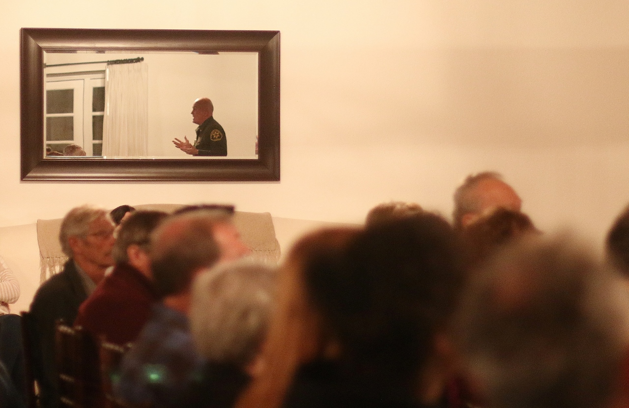 Lt. Mike Peters (reflected in the mirror), chief of San Clemente Police Services, fields questions during a community forum on homeless populations on Jan. 24 at Casino San Clemente. Photo: Eric Heinz