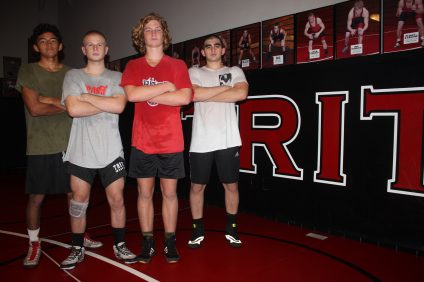 Tritons wrestler Josh Tabb (red) earned a tournament win at 171 pounds in the Ed Springs Invitational on Dec. 23. Photo: File