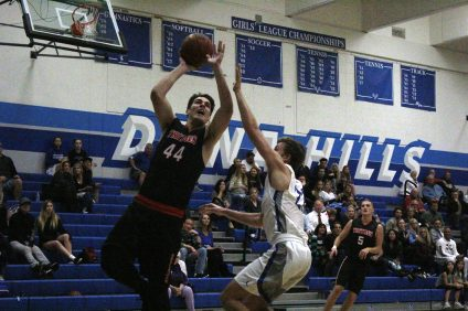Max Marshall (left) of San Clemente attempts a shot against Dana Hills. San Clemente defeated Dana Hills, 60-42. Photo: Zach Cavanagh