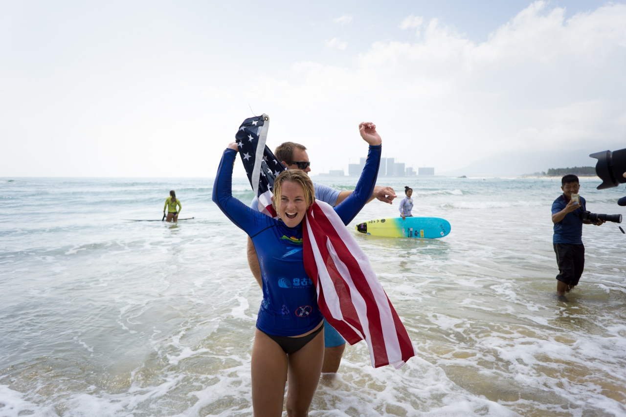 San Clemente-native Tory Gilkerson emotes after winning the gold medal for the women's division of the 2018 ISA World Longboard Surfing Championship on Jan. 25 at Riyue Bay in Wanning, China. Photo: Courtesy of ISA/Sean Evans