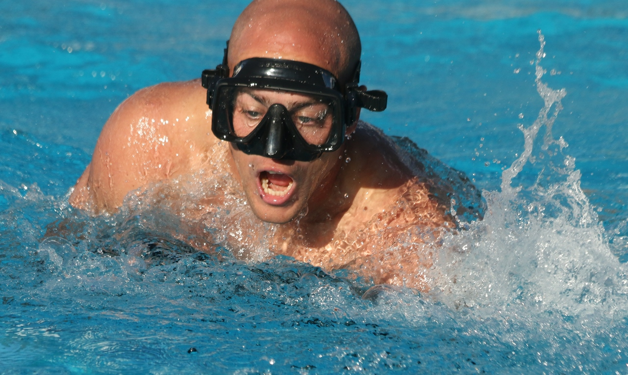 An underwater torpedo player takes a large gasp of air before diving under to join the match in the first Aquabowl of the Underwater Torpedo League on Jan. 27 at the San Clemente Aquatics Center.