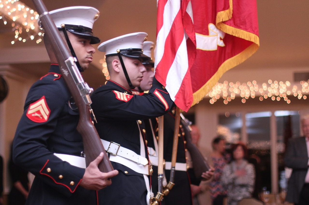 Members of the color guard with the 2nd Battalion, 4th Marines opens the awards ceremony.