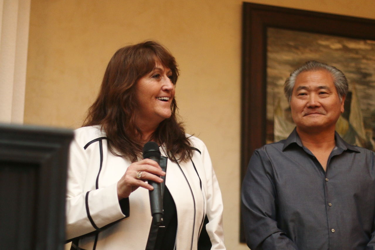 Kelly, left, and Roger Sugano speak to the audience after being awarded Business of the Year.