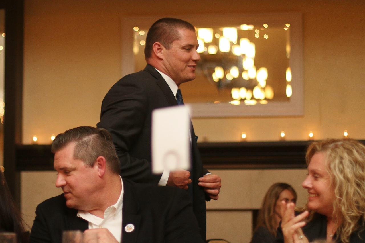 Lance Larson makes his way to receive the Volunteer of the Year award.