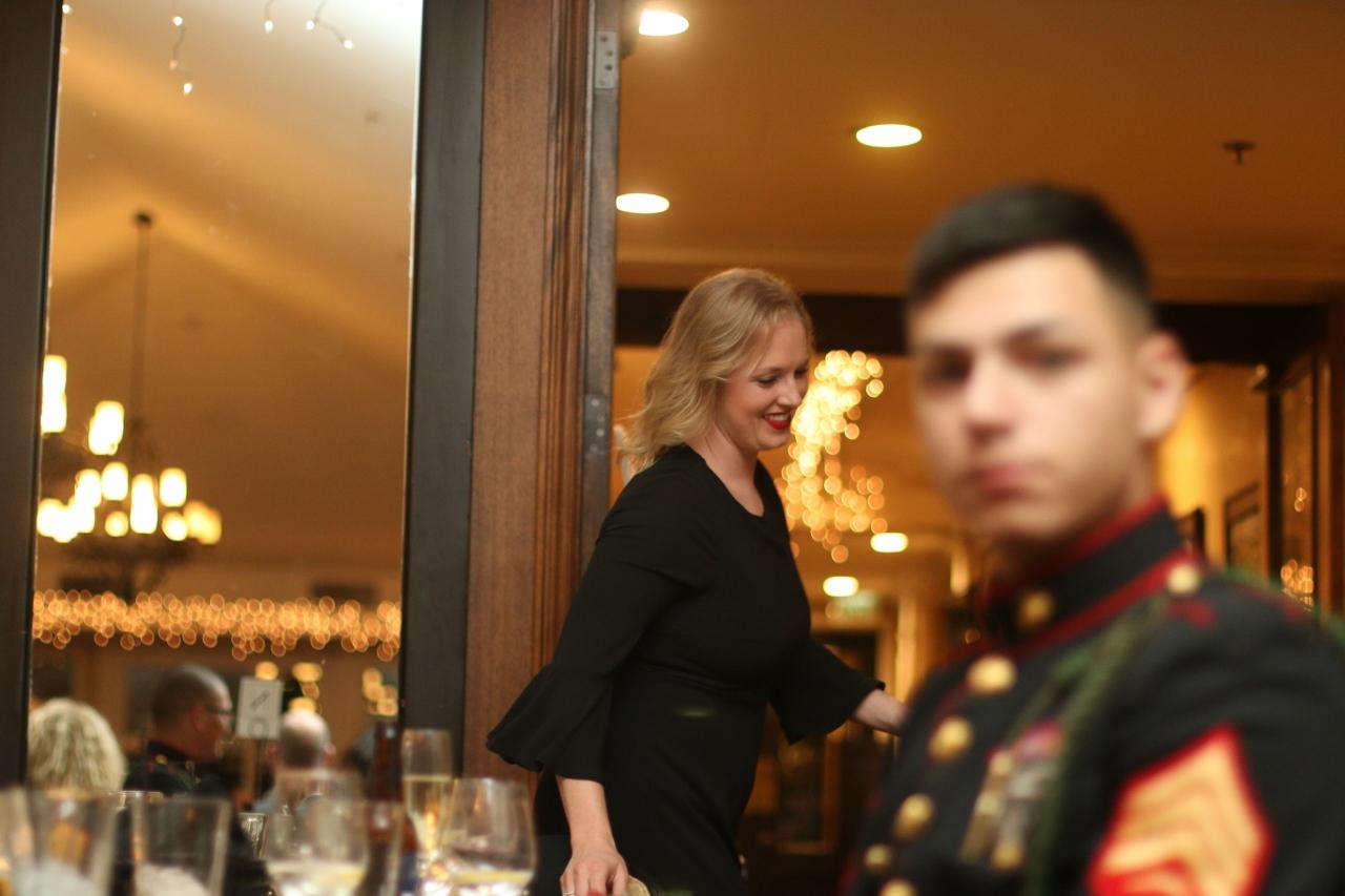 Shauna Hunt walks to the podium to receive the Ambassador of the Year award.