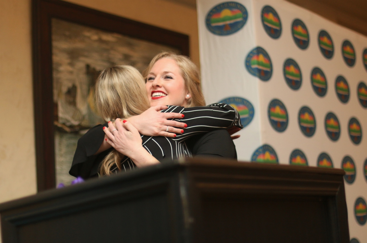 Shauna Hunt receives a hug from Kelly Finney during the annual San Clemente Chamber of Commerce Installation of Officers and Awards Ceremony on Feb. 15 at Bella Collina San Clemente.