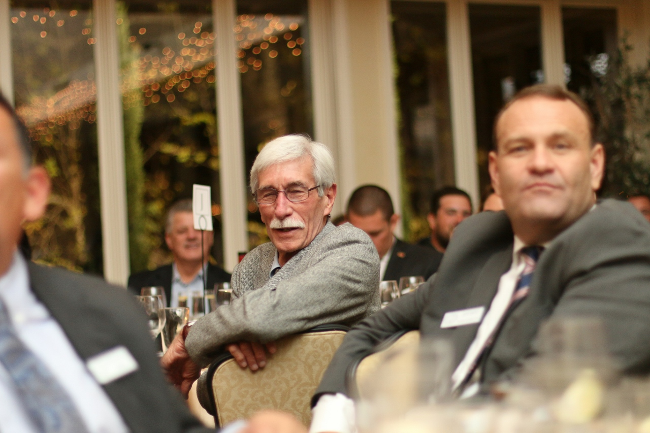 Chamber board member Chuck Narey listens to speakers during the ceremony.