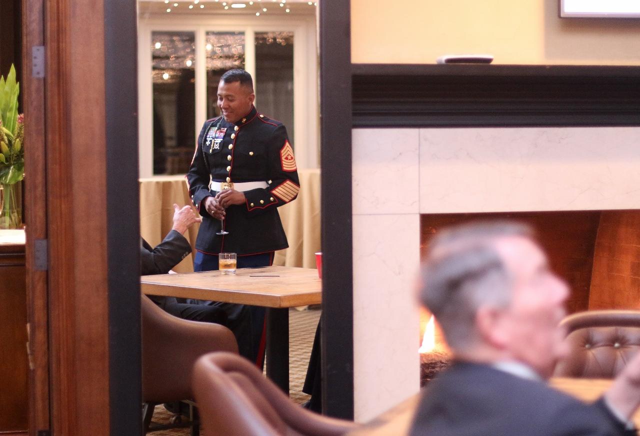 USMC Sgt. Major Jose Molina converses outside the award ceremony room.