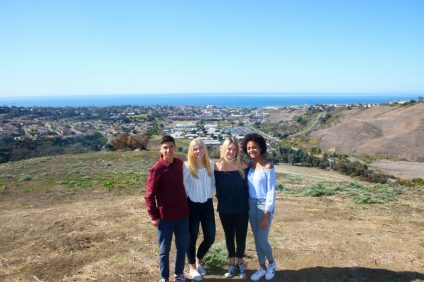 From left, Future Problem Solvers members Nick Petrocelli, co-president Sophia Mains, co-president Chloe Kamp and Esther Mafouta stand at the top of Nob Hill where a fire broke out in December. The club aims to create more fire-deterrent information along San Clemente's trails and open space. Photo: Eric Heinz