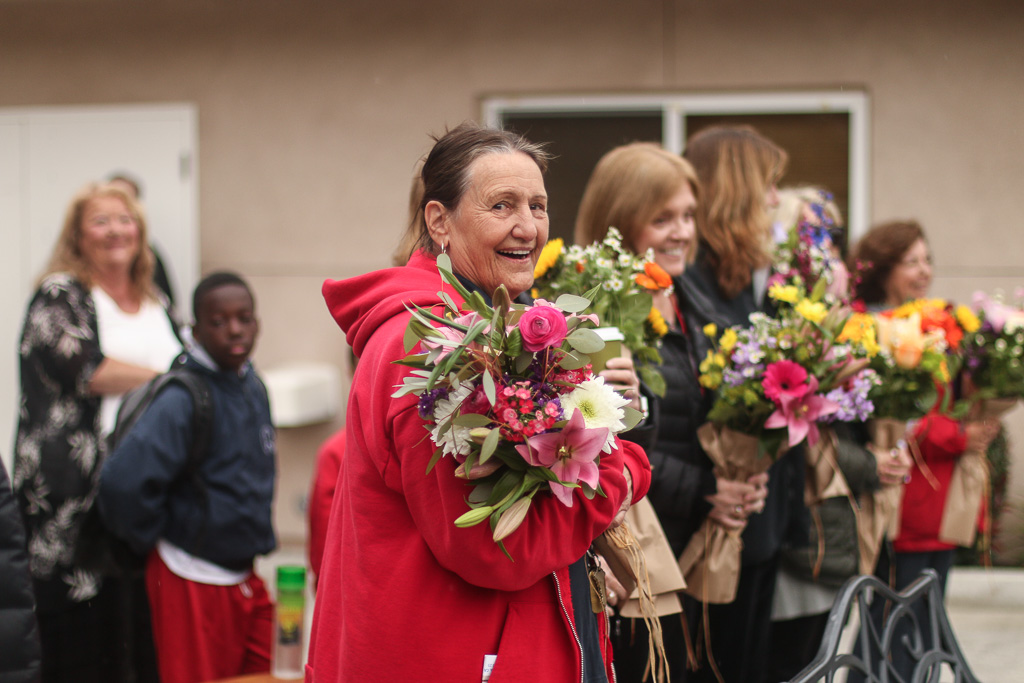 Cindy Baas has taught at Our Saviro's Lutheran School for more than 30 years. Teachers were given bouquets of flowers on March 22. Photo: Eric Heinz