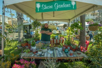 Wyatt Murphy, manager of Shore Gardens Nursery, promotes organic agriculture at Earth Day on April 21 in San Clemente. Photo: Brennan Stevens for the San Clemente Times