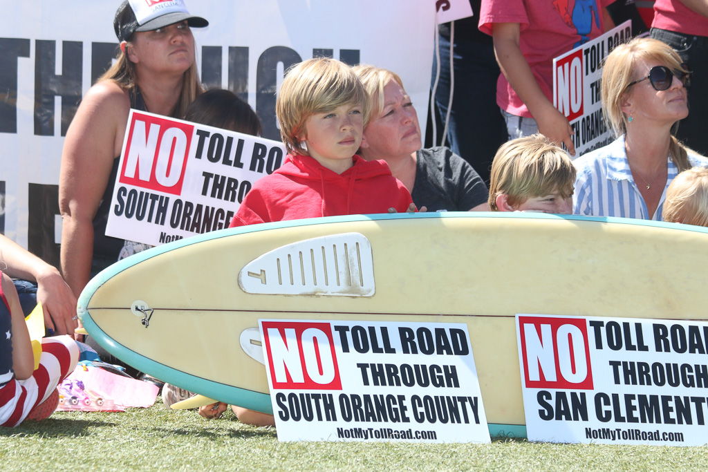 Dozens of people from San Clemente and surrounding cities came to support a press conference on a new State Assembly bill aimed to curtail The Toll Roads on Tuesday, May 8 at Vista Hermosa Sports Park. Photo: Eric Heinz