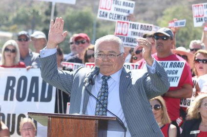 Assemblymember Rocky Chávez, R-76, leads a rally cry for his new bill that would curtail the efforts of The Toll Road administrators on Tuesday, May 8 at Vista Hermosa Sports Park. Photo: Eric Heinz