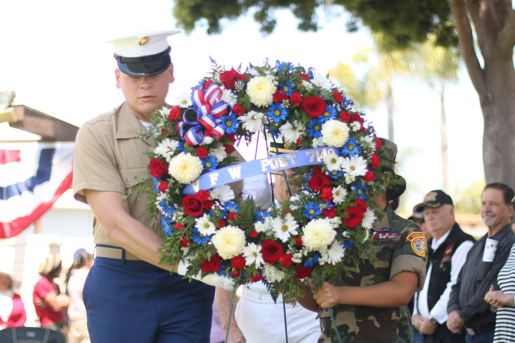 Wreaths are presented to honor those who have died while serving in the military during a ceremony on May 28 in recognition of Memorial Day.