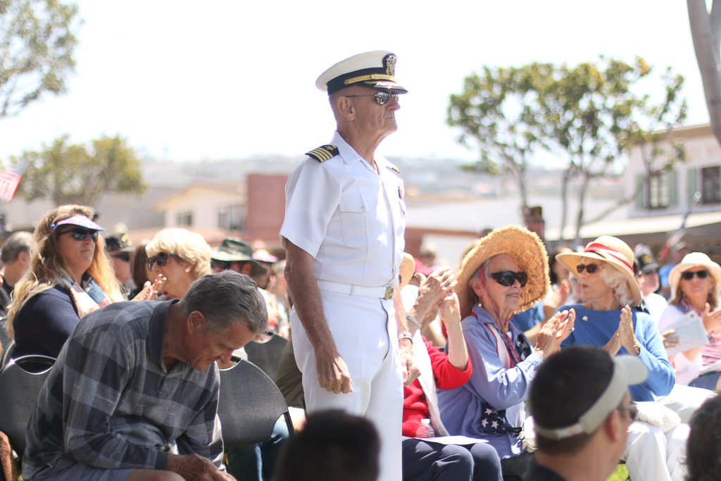 Wayne Greenleaf, a San Clemente resident and former member of the U.S. Navy, stands as he's recognized with other members of the military on May 28 for Memorial Day.