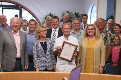 Fred Swegles, center, wrote for the 'Sun Post News' for 46 years in San Clemente before being laid off. He was recognized for his work at the June 19 City Council meeting. Photo: Eric Heinz