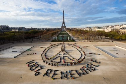 Artist John Quigley is known for his aerial photos that bring attention to the Earth's most pressing environmental issues. Pictured, he orchestrated people to make this form in Paris. Photo: Courtesy of John Quigley