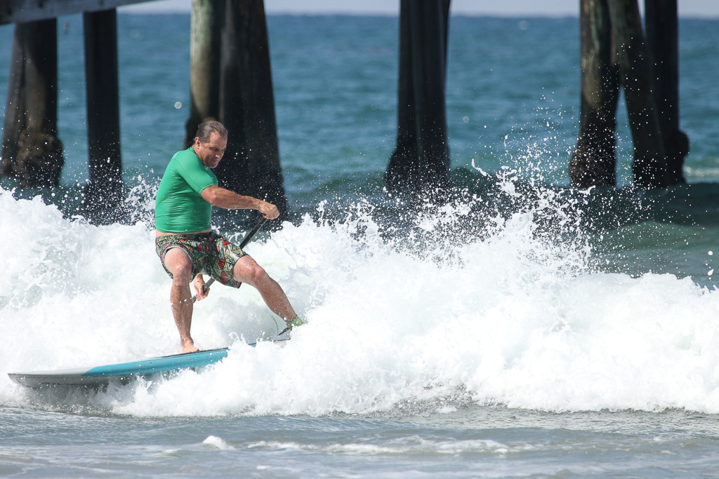Local artist Drew Brophy shows his skills during a heat of the stand-up paddle surf competition on July 21 at the San Clemente Ocean Festival. Photo: Eric Heinz