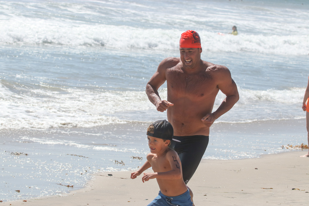 This little guy couldn't wait to grow up to be big and strong, but he settled for being fast during the run-swim-run relay competitions on Sunday, July 22, at the San Clemente Ocean Festival. Photo: Eric Heinz