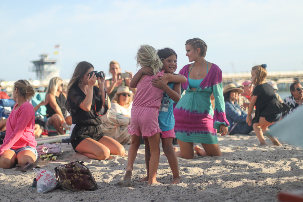 Mimi, left, and her friend, Chantall Nardelli, dance to the music at the beach concert on Saturday, July 21, at the San Clemente Ocean Festival. Photo: Eric Heinz