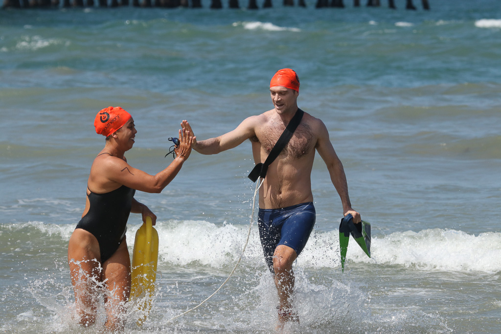 High-fives all around during the July 21 swim rescue competitions at the San Clemnte Ocean Festival. Photo: Eric Heinz