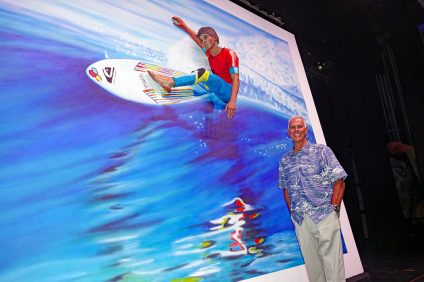 San Clemente artist Gary Prettyman stands beside a living picture of his Kelly Slater painting 'Cutting Glass,' backstage at the 2018 Pageant of the Masters. Pageant cast member Joseph Marquez, 15, of San Clemente, portrays Kelly Slater. Photo: Fred Swegles