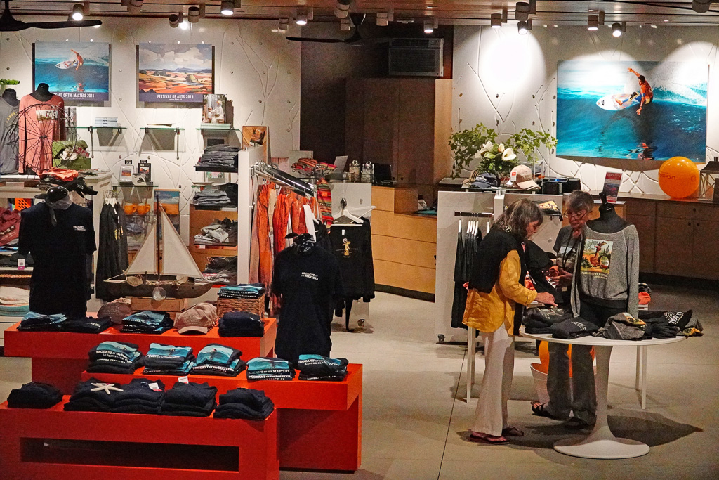 Souvenir copies of San Clemente surf artist Gary Prettyman's painting 'Cutting Glass' are prominently displayed in the Laguna Beach Festival of Arts' gift shop, together with souvenir T-shirts in the foreground. Photo: Fred Swegles