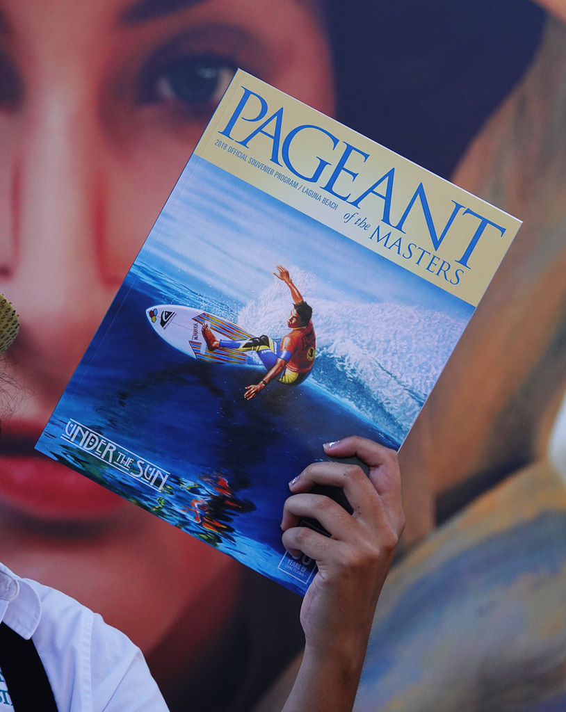San Clemente surf artist Gary Prettyman's acrylic painting 'Cutting Glass' adorns the cover of the 2018 Laguna Beach Pageant of the Masters program on sale on the Festival of Arts grounds. Photo: Fred Swegles